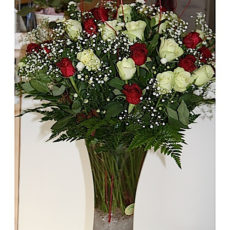 White and Red Roses in glass vase
