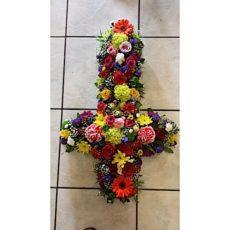 Colourful flower arrangement cross