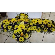 Yellow daisy and rose cross floral arrangment
