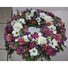 Colourful white, pink and purple daisy floral arrangement wreath