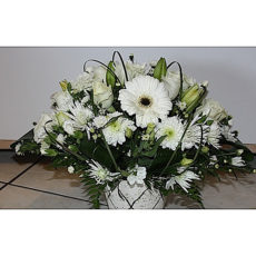 White daisy and rose floral arrangement in white vase