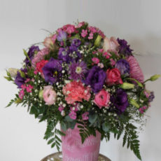 Colourful arrangement of Pink and Purple Roses