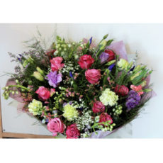 Colourful Bouquet of Pink and Purple Roses and White Carnations