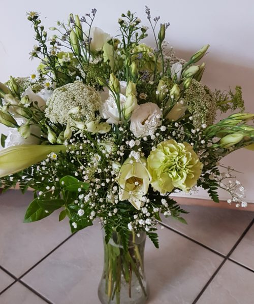 White Roses and Greenery arrangement in glass vase