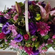 Pink Rose, Purple Rose, Pink Lily and Pink Daisy Basket Arrangement
