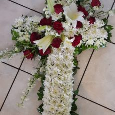 White Daisy, White Lilly and Red Rose Cross Arrangment
