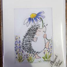 Hedgehog holding flower card