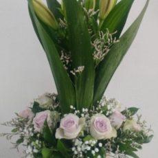 Purple rose and greenery arrangement